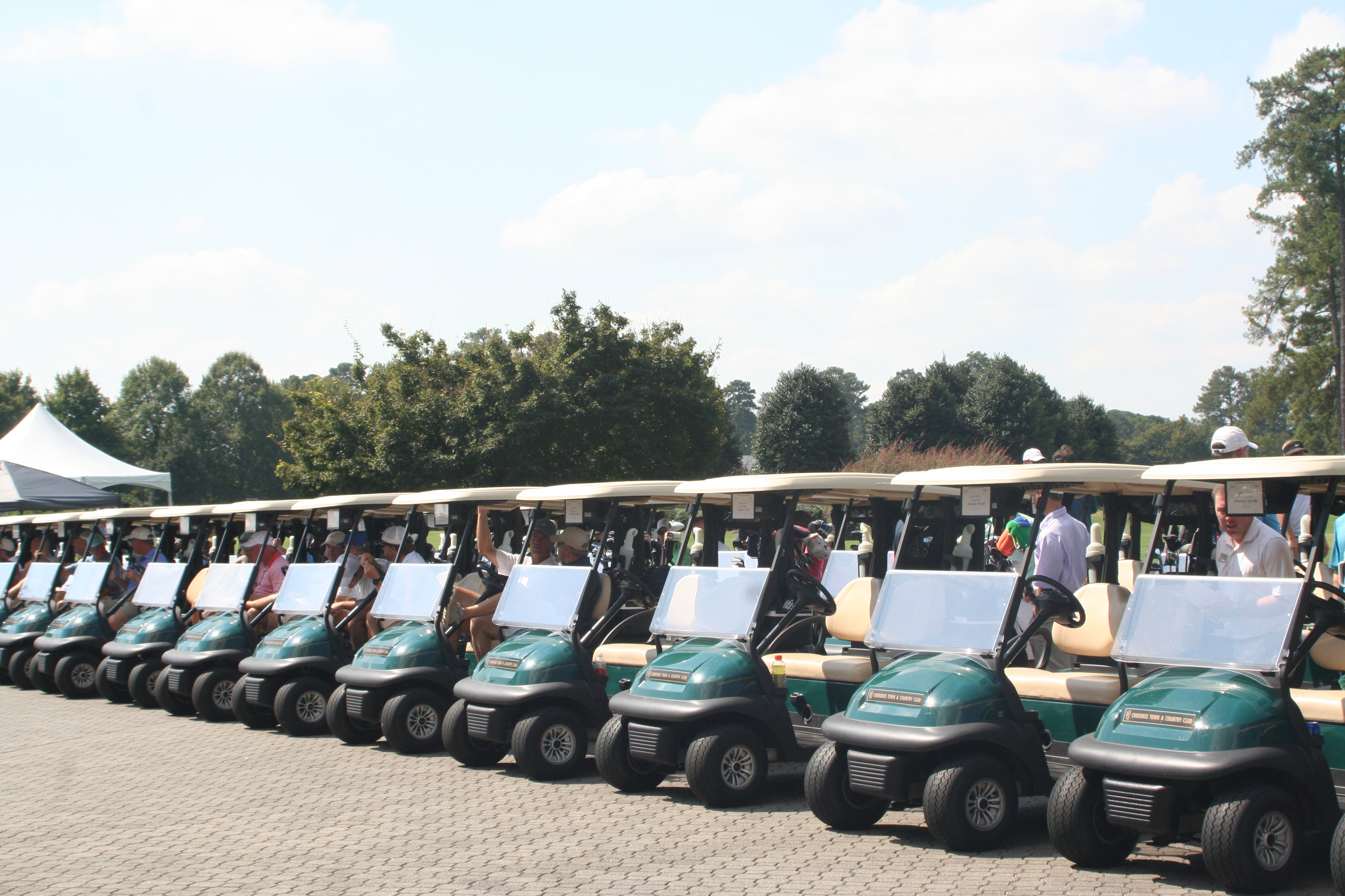 Golf carts lined up at largest charity golf tournament in Atlanta