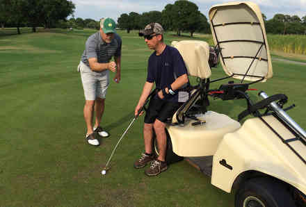 Two men participating in recreation therapy golf clinic