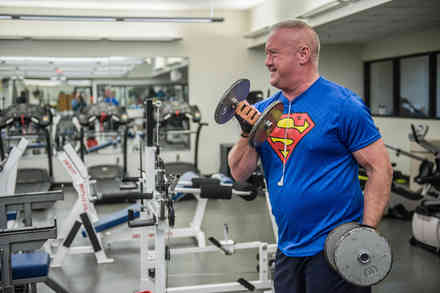 Patient Ricky Hales lifts dumbbells in the ProMotion weight room at Shepherd Center