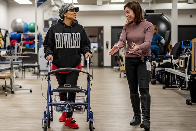 Multiple Sclerosis patient working with therapist at Shepherd Center