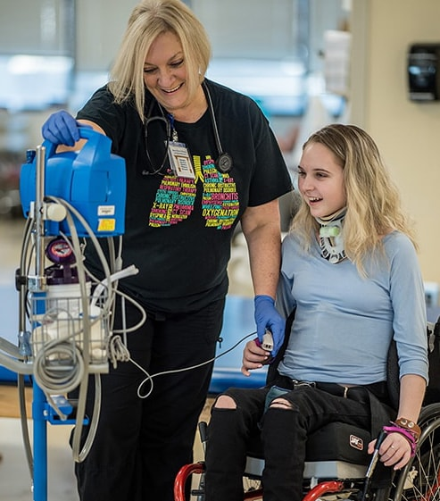 Respiratory Therapist Kelley Taylor with adolescent patient
