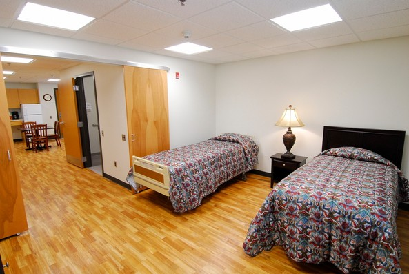A family residence apartment with two beds and a kitchen at Shepherd Center's rehabilitation facility