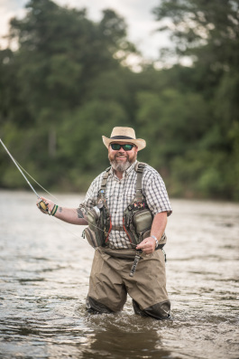 SHARE client fly fishing in lake as part of the Project Healing Waters program for disabled military veterans