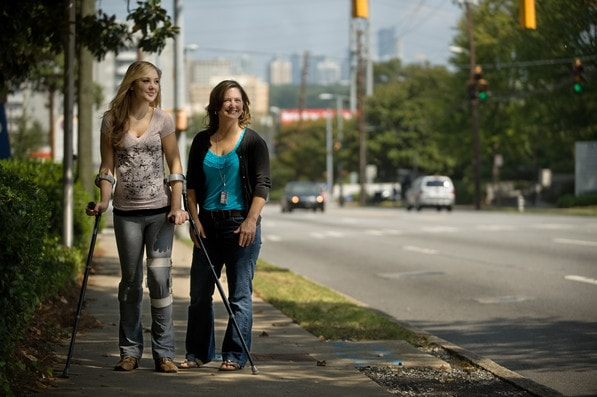 Shepherd Center patient Jen Lindquist stands on a sidewalk