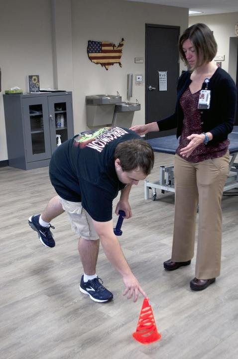 SHARE Military Initiative Client Works on Balance with Physical Therapist