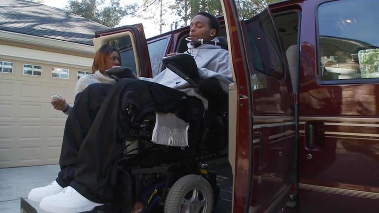 Man uses wheelchair lift to enter a vehicle