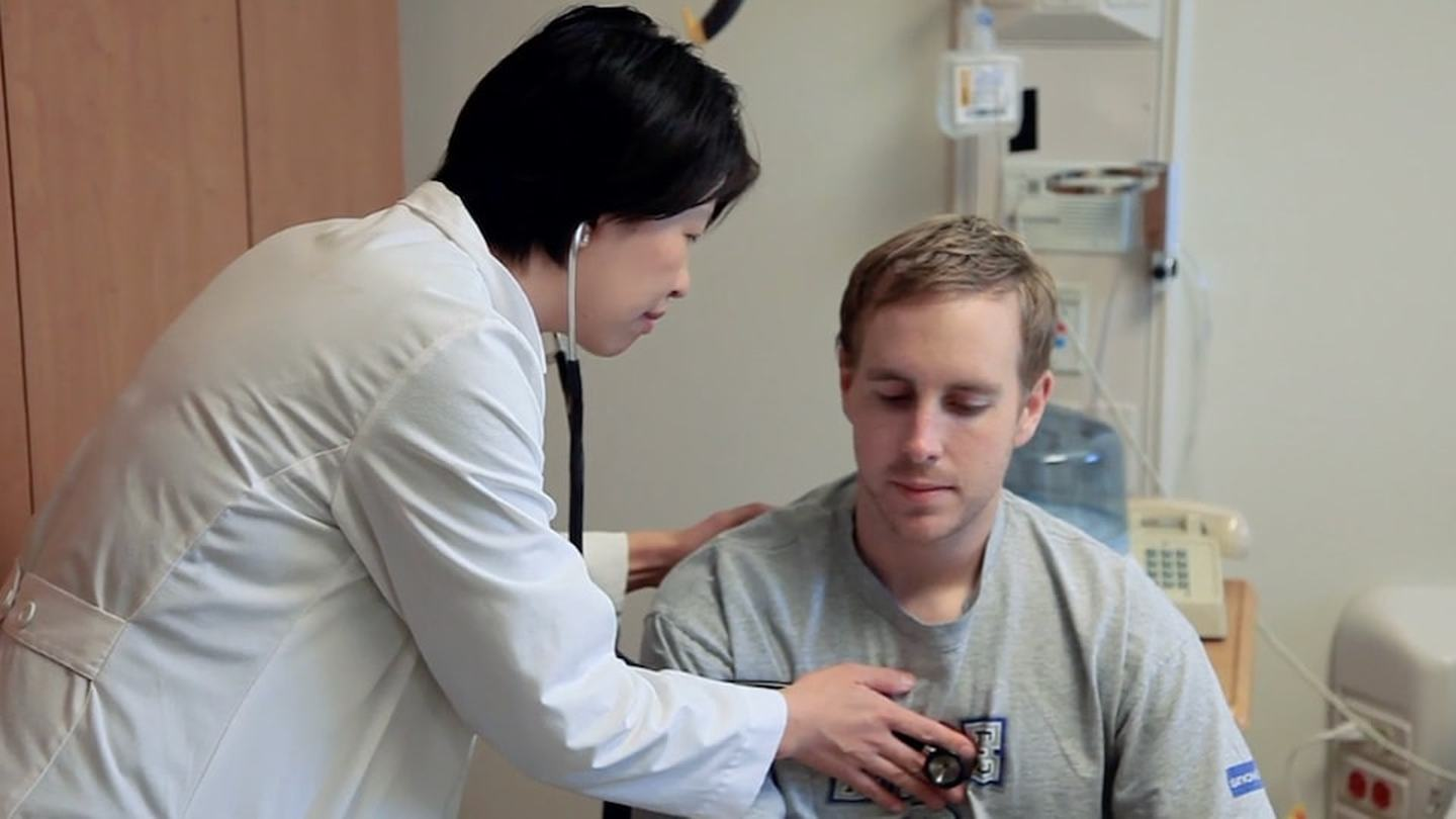 Dr. Anna Elmers uses a stethoscope to listen to a patient's heartbeat
