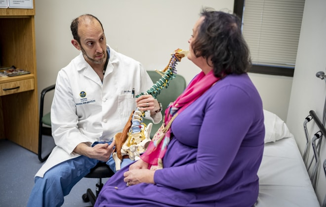 Dr. Erik Shaw meets with patient at the Spine and Pain Institute