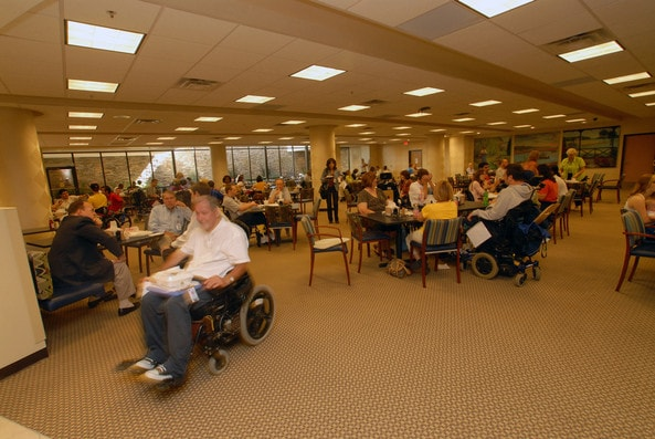 Patients and staff eat a meal in the cafeteria at Shepherd Center in Atlanta, Georgia