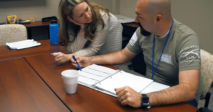 SHARE client working with speech-language pathologist