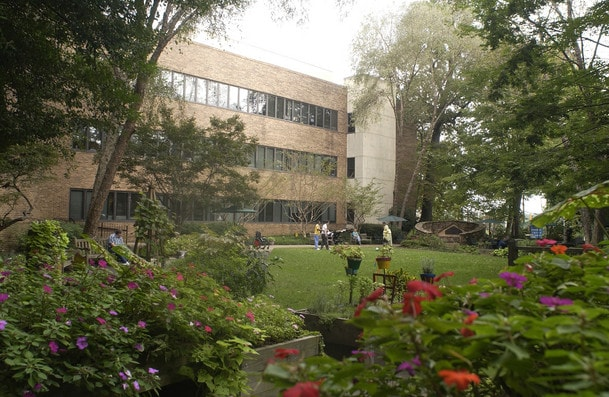 Shepherd Center patients and staff participate in therapy in a garden on the hospital campus