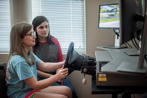 Stroke patient Amelia Holley using adaptive driving equipment