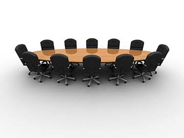 A conference table with 12 black chairs