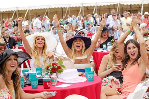 Women cheering at Shepherd Center's Derby Day fundraising event