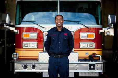 Lamar Matthews stands in front of a fire engine