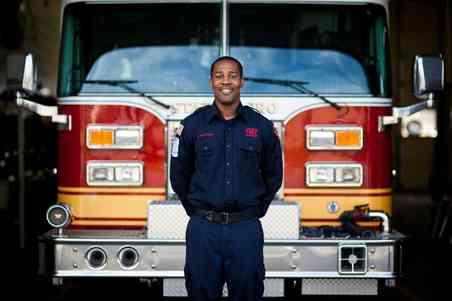 Lamar Matthews Webb in front of fire truck for Shepherd's RESCUE Program