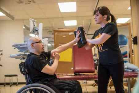 Patient undergoes rehabilitation therapy at Shepherd Center