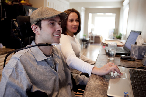 Patient learning to use assistive technology at Shepherd Center