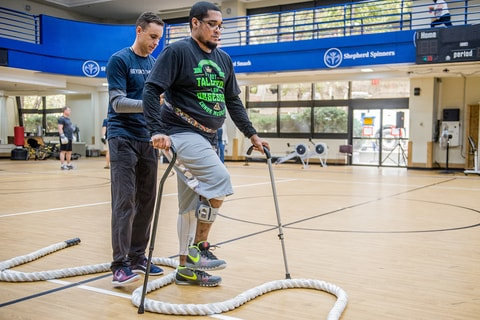 Nick Evans assists patient recovery with physical therapy in Beyond Therapy program