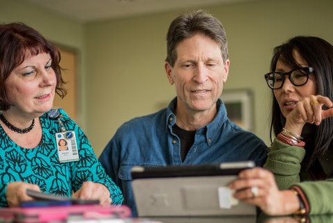 A family member meets with Shepherd Center specialists to review a patient recovery plan