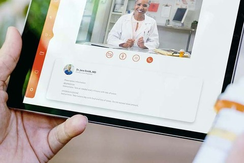 A person uses telehealth for a video visit with their medical provider using a tablet computer