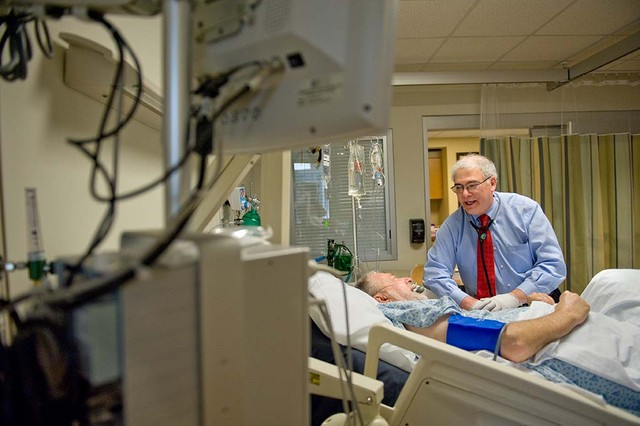 Dr. Guy Buckle assists inpatient at Shepherd Center