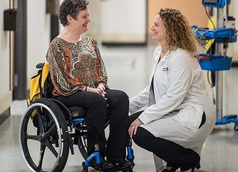 Dr. Angela Beninga talks with a patient at Shepherd Center's outpatient rehabilitation program