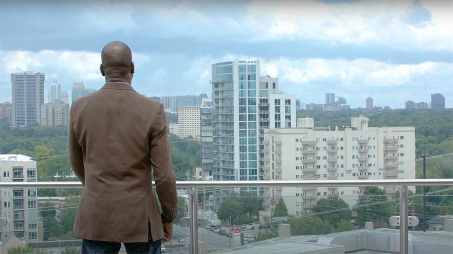 Man looking out across Atlanta skyline