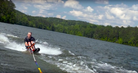 Former Shepherd Center patient uses water skis at Camp ASW