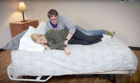 Couple demonstrates example of sex position for women with spinal cord injury